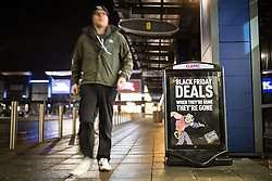 © Licensed to London News Pictures . 27/11/2015 . Manchester , UK . A man walks passed a show sign offering Black Friday deals outside a branch of Game in Cheetham Hill in North Manchester this morning (Friday 27th November) . Last year (2014) scuffles and fights were reported amongst queuing bargain-hunters . Photo credit: Joel Goodman/LNP