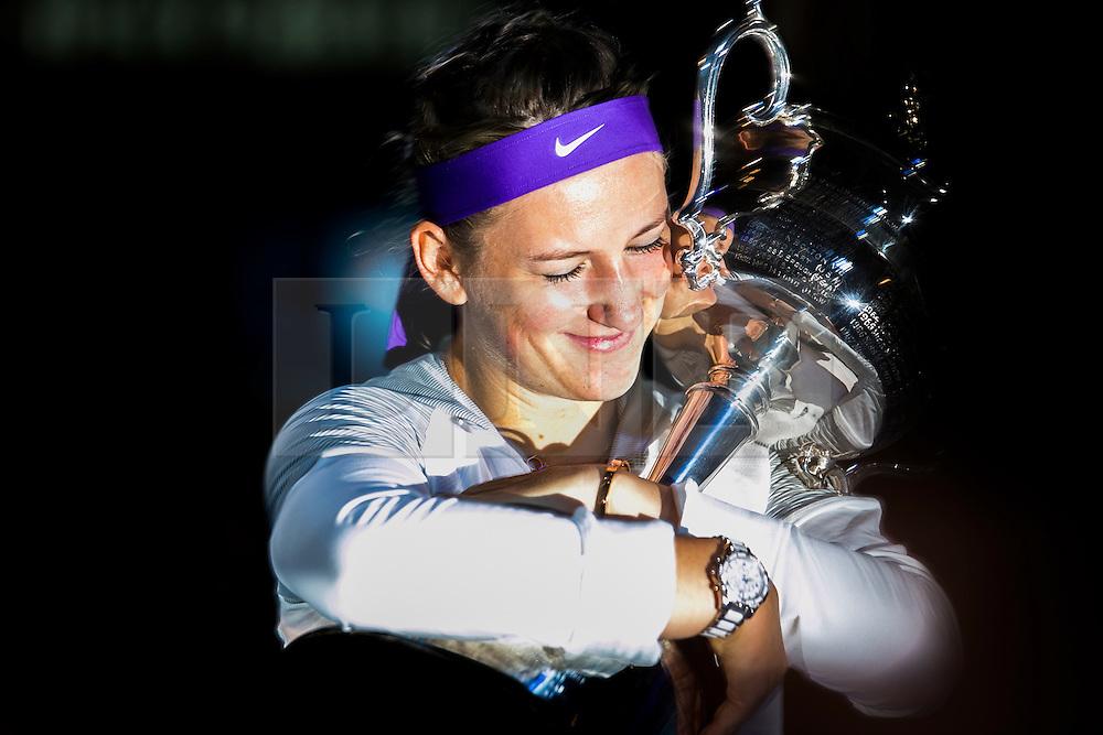 © Licensed to London News Pictures. 26/01/2013. Melbourne Park, Australia. Victoria Azarenka hugs her winner trophy while closing her eyes during the Womens Final between Victoria Azarenka and Li Na of the Australian Open. Photo credit : Asanka Brendon Ratnayake/LNP