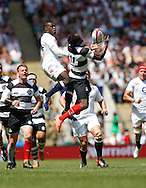 Picture by Andrew Tobin/Tobinators Ltd +44 7710 761829.26/05/2013.Christian Wade of England and Timoci Nagusa of the Barbarians compete for a high ball during the match between England and the Barbarians at Twickenham Stadium, Twickenham.