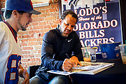 SHOT 12/10/17 12:58:34 PM - Former Buffalo Bills wide receiver and Hall of Fame player Andre Reed signs autographs and meets with fans at LoDo's Bar and Grill in Denver, Co. as the Buffalo Bills played the Indianapolis Colts that Sunday. Reed played wide receiver in the National Football League for 16 seasons, 15 with the Buffalo Bills and one with the Washington Redskins. (Photo by Marc Piscotty / © 2017)