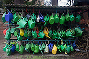 The watering cans of cemetery visitors which help water the graves of loved-ones are locked up on a rack in Domfriedhof in Wedding, a north-western district of Berlin.
