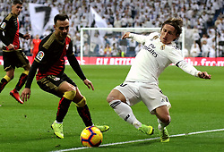 MADRID, Dec. 16, 2018  Real Madrid's  Luka Modric (R) vies with Rayo Vallecano's Jordi Amat during a Spanish league match between Real Madrid and Rayo Vallecano in Madrid, Spain, on December 15, 2018. Real Madrid won 1-0. (Credit Image: © Edward F. Peters/Xinhua via ZUMA Wire)