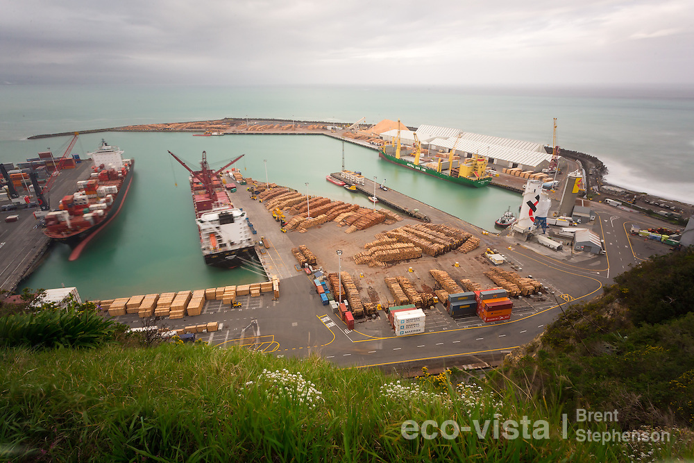 Looking down into Napier Port from Napier Hill, with a storm surge breaking around the port, and a moody cloudy sky. Long exposure with blurred action. Napier Port, Hawkes Bay, New Zealand. September.