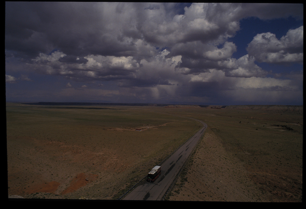 Tour bus on highway west of Rough Rock.   1993