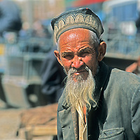 A Uygar man watches the weekly bazaar in Kashgar (Kashi), a town on the ancient Silk Road in Xinjiang, China.