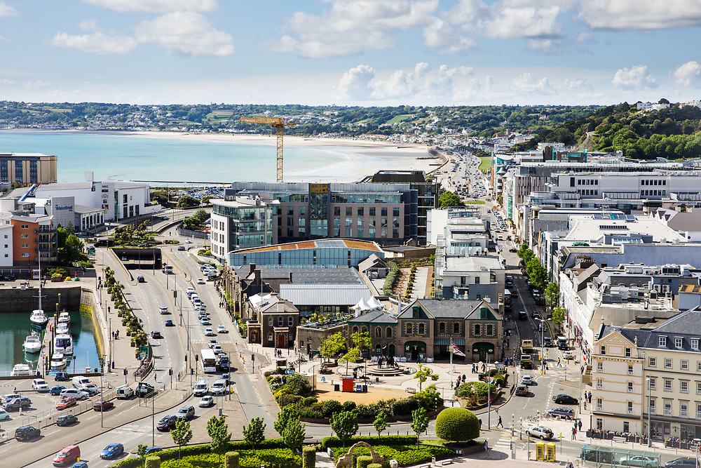 Elevated view of Liberty Wharf and the busy roads along the waterfront of St Aubin's Bay, Jersey, CI
