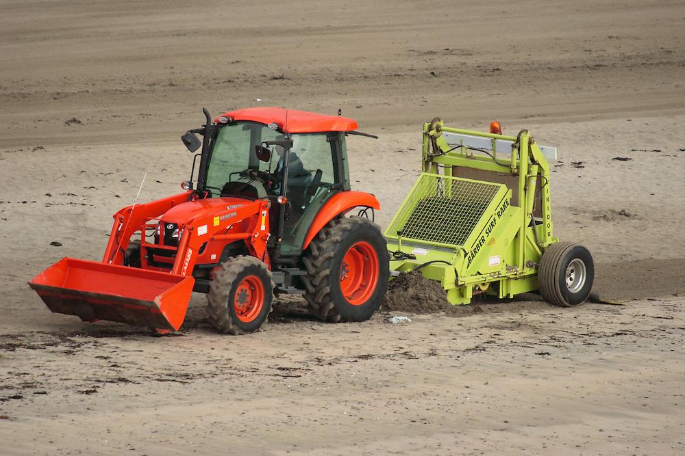 Mechanical beach cleaning - Raking strandline at Looe, Cornwall