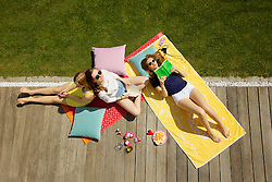 Teenage Girls Hanging Out in Garden, Elevated View