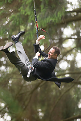 Martin Milner after tying the knot in the trees at Go Ape Aberfoyle, heading to a zip wire to the climbing net.
