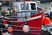 Cobh harbour with brightly coloured fishing boat in County Cork, Ireland