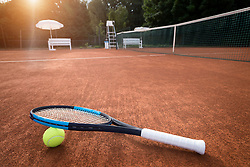Close-up of tennis ball and racket on playing field, Bavaria, Germany