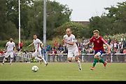 Ünal Kaya on the attack for Northern Cyprus. Karpatalya (RED) beat Northern Cyprus (WHITE) 3 -2 in penalties during the Conifa Paddy Power World Football Cup finals on the 9th June 2018 at Queen Elizabeth II Stadium in Enfield Town in the United Kingdom. Team mates from the Turkish Republic of Northern Cyprus  take on the Hungarians in Ukraine for the CONIFA World Football Cup final. CONIFA is an international football tournament organised by CONIFA, an umbrella association for states, minorities, stateless peoples and regions unaffiliated with FIFA. (photo by Sam Mellish / In Pictures via Getty Images)