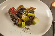 New York, NY, Sept. 10....shots of the restaurant Estela. Steak with eggplant, leeks  and anchovies.