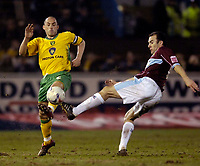 Photo: Jed Wee.<br /> Burnley v Norwich City. Coca Cola Championship. 24/03/2006.<br /> <br /> Norwich's Craig Fleming (L) challenges Burnley's Graham Branch for the ball.