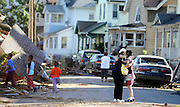 People embrace on a street damaged yesterday's tornado in Springfield, Mass. Residents of 19 small communities in central and western Massachusetts were left to deal with widespread damage Thursday, one day after at least two late-afternoon tornadoes shocked emergency officials and residents more accustomed to dealing with snow and bone-chilling cold than funnel clouds spawned by spring storms. (AP Photo/Jessica Hill)