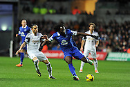Romelu Lukaku of Everton © is challenged by Swansea city's Chico Flores. Barclays Premier league, Swansea city v Everton at the Liberty Stadium in Swansea,  South Wales on Sunday 22nd Dec 2013. pic by Andrew Orchard, Andrew Orchard sports photography.