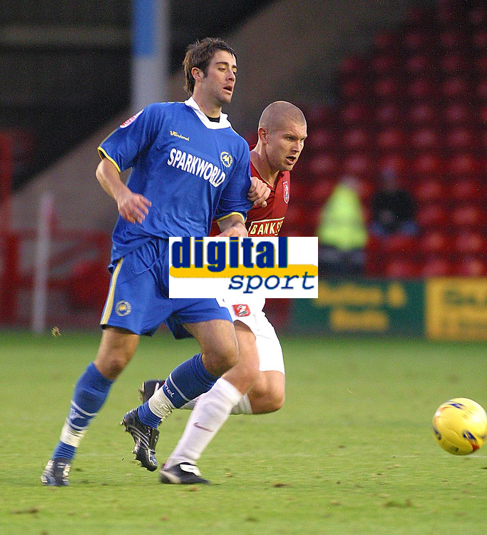 Photo: Dave Linney.<br />Walsall v Torquay United. Coca Cola League 2. 04/11/2006. Torquay sub Michael Leary(L) battles with  Michael Dobson