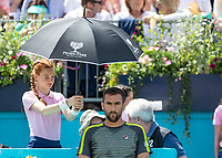 Tennis - 2019 Queen's Club Fever-Tree Championships - Day One, Monday<br /> <br /> Men's Singles, First Round: Marin Cilic (CRO) Vs. Christian Garin (CHL)  <br /> <br /> Marin Cilic (CRO) gets shelter from the sun on Centre Court.<br />  <br /> COLORSPORT/DANIEL BEARHAM