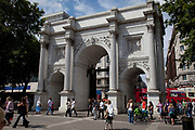 Marble Arch in central London. Marble Arch is a white Carrara-marble monument at the junction of Oxford Street, Park Lane, and Edgware Road. A popular tourist sight.