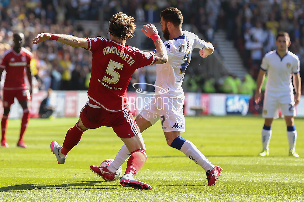 Middlesbrough defender, on loan from Fulham, Fernando Amorebieta tackles Leeds United forward Mirco Antenucci    during the Sky Bet Championship match between Middlesbrough and Leeds United at the Riverside Stadium, Middlesbrough, England on 27 September 2015. Photo by Simon Davies.