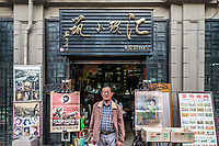 Shanghai, China - April 7, 2013: man in front of Souvenirs handcratf shop store Duolun Road Hongkou District at the city of Shanghai in China on april 7th, 2013