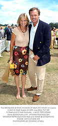 The MARQUESS & MARCHIONESS OF MILFORD HAVEN at a polo match in West Sussex on 20th July 2003.PLP 149