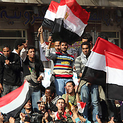 Young men rally the crowd during the Day of Justice and Cleansing in Cairo's Tahrir Square.