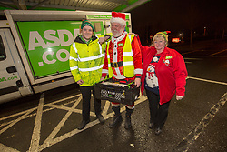 Andy Law, the Dundee Asda delivery driver that has become a hit with customers after dressing up as Santa. Pic with colleagues Cameron Watt and Dawn McCann.