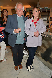 DESMOND GUINNESS and his wife PENNY GUINNESS at the launch of the 'Jasmine for Jaeger' fashion collection by Jasmine Guinness for fashion label Jaeger held at Fenwick's, Bond Street, London on 9th September 2015.