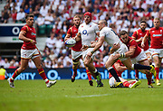 England's Mike Brown off-loads as he is tackled by Wales' George North during the The Old Mutual Wealth Cup match England -V- Wales at Twickenham Stadium, London, Greater London, England on Sunday, May 29, 2016. (Steve Flynn/Image of Sport)