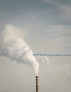 Air pollution in downtwon Ulan Bator near one of the coal-fired power plant located on the edge of the city. Burning fossil fuels is the primary source of both climate-warming emissions and health-damaging air pollution.<br /> Mongolia