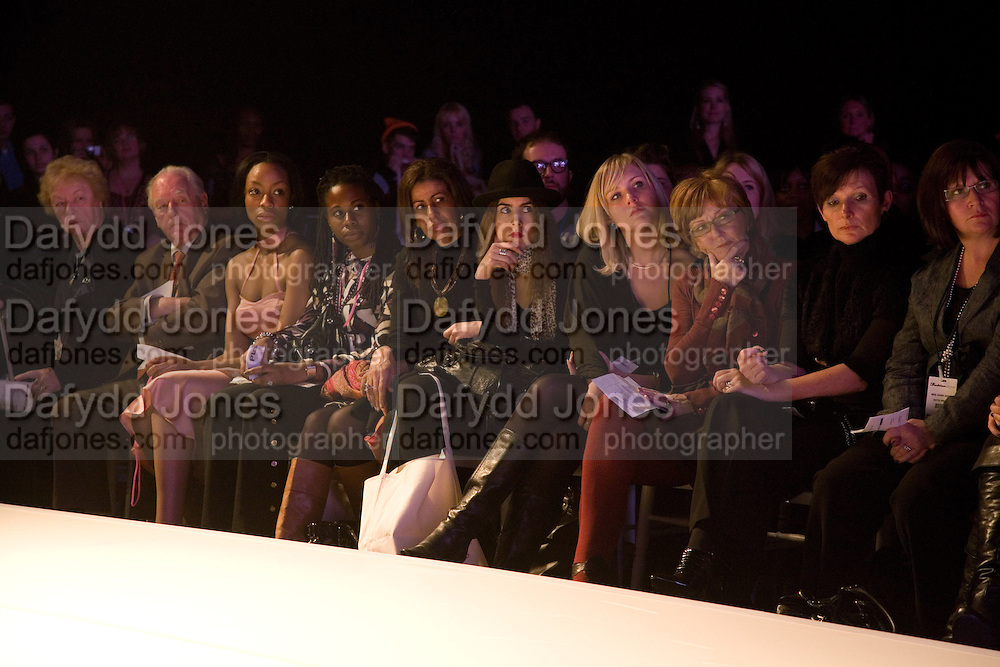 WATCHING FASHION SHOW, FashionExpo, fashion show and Awards. Business Design Centre, Upper st. London. 19 November 2008.  *** Local Caption *** -DO NOT ARCHIVE -Copyright Photograph by Dafydd Jones. 248 Clapham Rd. London SW9 0PZ. Tel 0207 820 0771. www.dafjones.com