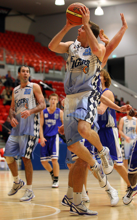 PERTH, AUSTRALIA - JULY 16: Troy Thomson of the Tigers drives to the basket during the week 18 SBL game between the Perry Lakes Hawks and the Willetton TIgers at The State Basketball Center on July 16, 2011 in Perth, Australia.  (Photo by Paul Kane/Allsports Photography)