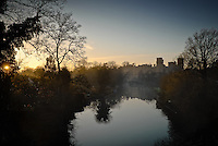 View of Warwick Castle from the Banbury Road Bridge over the River Avon, Warwick, Warwickshire, England, UK