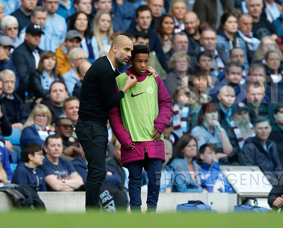 Josep Guardiola manager of Manchester City speaks to a ball boy during the premier league match at the Etihad Stadium, Manchester. Picture date 22nd September 2017. Picture credit should read: Simon Bellis/Sportimage