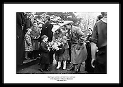 Roy Rogers og kona Dale Evans møter gutter fra St Augustine's School i Blackrock 1954. Rogers var.en amerikansk sanger og cowboy skuespiller, og en av verdens tyngst markedsførte stjerner.på sin tid. Han og Dale Evans var med i mer enn 100 filmer og The Roy Rogers Show.