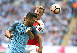 23 April 2017 FA Cup semi-final : Arsenal v Manchester City :<br /> Sergio Aguero of City is held by Rob Holding.<br /> Photo: Mark Leech