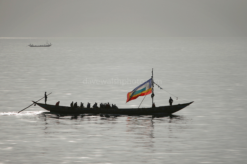 Pirogue going out to fish during a Solar Eclipse, Conakry, Guinea. The livelhihoods of these fishermen is under threat from unlicensed, unregulated ships from China and elsewhere. .
