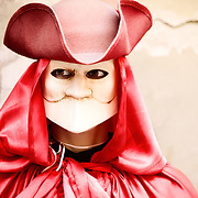 A mannequin wearing a venetian carnival costume and mask in Venice, Italy.<br />