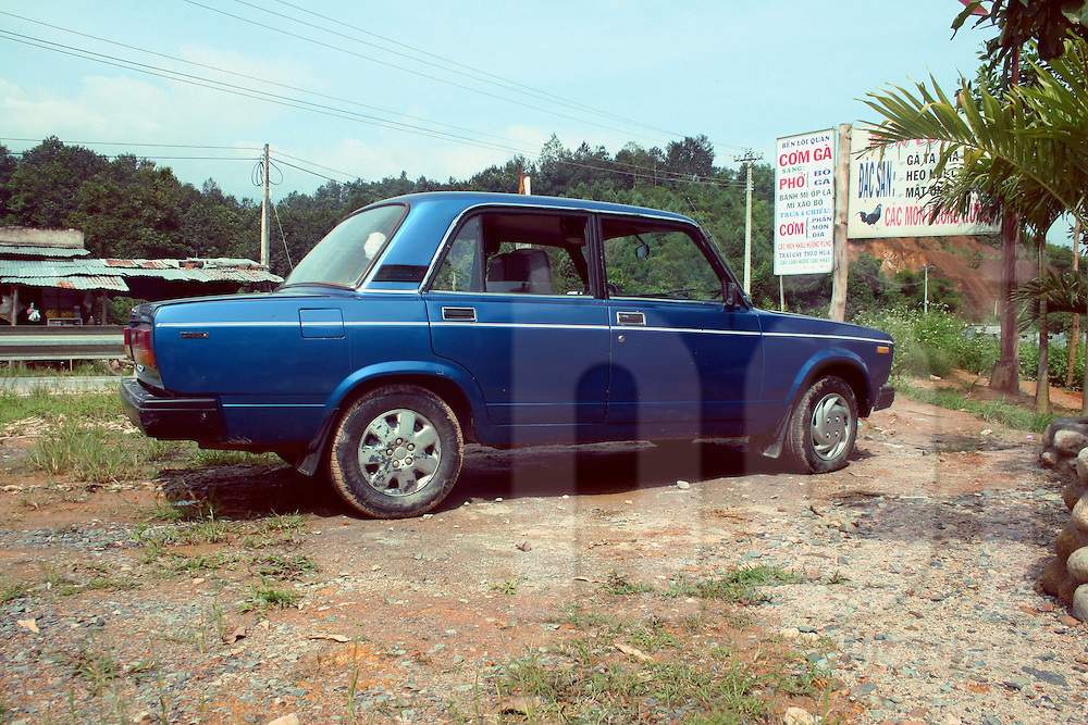 Old lada russian car.Rest stop, en route to Dalat from Nha Trang.Oct 2010.Vietnam