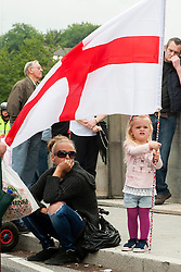 "Rotherham England<br /> 13 September 2014 <br /> EDL supporters outside Main Street Police station where the EDL held a rally as part of the English Defence Leagues ""Justice for the Rotherham 1400"" March described by an EDL Facebook Page as ""a protest against the Pakistani Muslim grooming gangs"" on Saturday Afternoon <br /> <br /> <br /> Image © Paul David Drabble <br /> www.pauldaviddrabble.co.uk"