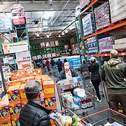 A line forms inside Costco for people to get paper products such as paper towels, napkins and toilet paper. There was only one pallet on the floor when the store opened.