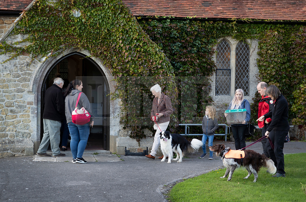 © Licensed to London News Pictures. 06/10/2019. Selsey, UK. Parishioners and their pets arrive at St Peter's Church in Selsey, West Sussex to part in the annual Service of Blessing of Animals  Parishioners bring their pets to the church for the annual service after earlier attending a Harvest Festival celebration. Photo credit: Peter Macdiarmid/LNP