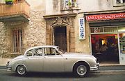 Old Jaguar in front of a cafe. Avignon. Rhone Valley, France