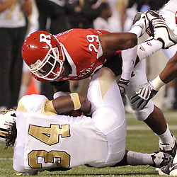 Dec 19, 2009; St. Petersburg, Fla., USA; Rutgers cornerback Zaire Kitchen (29) tackles UCF running back Brynn Harvey (34) during NCAA Football action in Rutgers' 45-24 victory over Central Florida in the St. Petersburg Bowl at Tropicana Field.