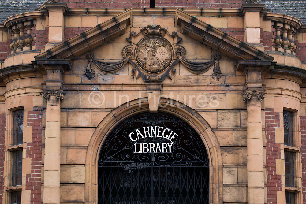 The frontage of Carnegie Library in Herne Hill. Faced with the closure of its local library, Lambeth council plan to close the facility used by the community as part of austerity cuts, saying they will convert the building into a gym and privately-owned gentrified businesses - rather than a much-loved reading and learning resource. £12,600 was donated by the American philanthropist Andrew Carnegie to help build the library which opened in 1906. It is a fine example of Edwardian civic architecture, built with red Flettan bricks and terracotta, listed as Grade II in 1981.