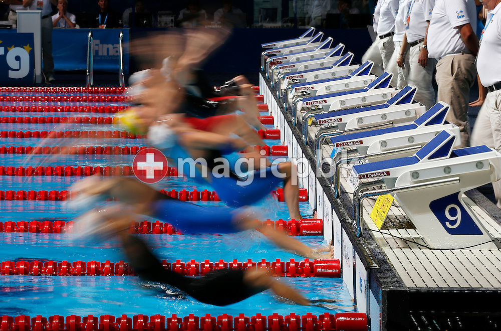 Swimmers start in the women's 4x100m Medley Relay Heat 2 during the 15th FINA World Aquatics Championships at the Palau Sant Jordi in Barcelona, Spain, Sunday, Aug. 4, 2013. (Photo by Patrick B. Kraemer / MAGICPBK)