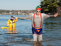 "Steve Small the ""Man of Steel"" did not waste any time getting back onto dry land during the 8th annual Turkey Plunge into Lake Opechee Saturday morning  (Karen Bobotas/for the Laconia Daily Sun)"
