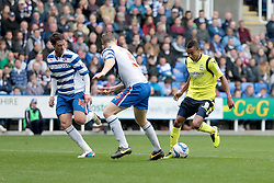 Birmingham City's  Jesse Lingard is watched by Reading's Alex Pearce - Photo mandatory by-line: Nigel Pitts-Drake/JMP - Tel: Mobile: 07966 386802 28/09/2013 - SPORT - FOOTBALL - Madejski Stadium - Reading - Reading V Birmingham City - Sky Bet Championship