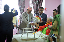April 28, 2017 - Kathmandu, NP, Nepal - Minister of State for Culture, Tourism and Civil Aviation Parshuram Tamang giving bunch of flower to Taiwanese hiker Liang Sheng-Yueh, who was found after missing for almost 47 days, during his birthday celebration at Grande International Hospital, Kathmandu, Nepal on Friday, April 28, 2017. (Credit Image: © Narayan Maharjan/NurPhoto via ZUMA Press)